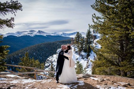 A couple snuggles on a winter day on squaw pass for their adventure elopement in Colorado