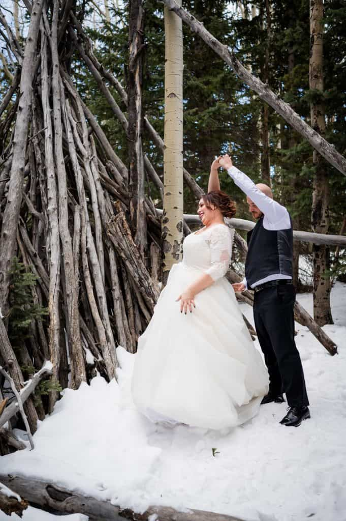 A couple dances in front of a teepee at their Idaho Springs Elopement