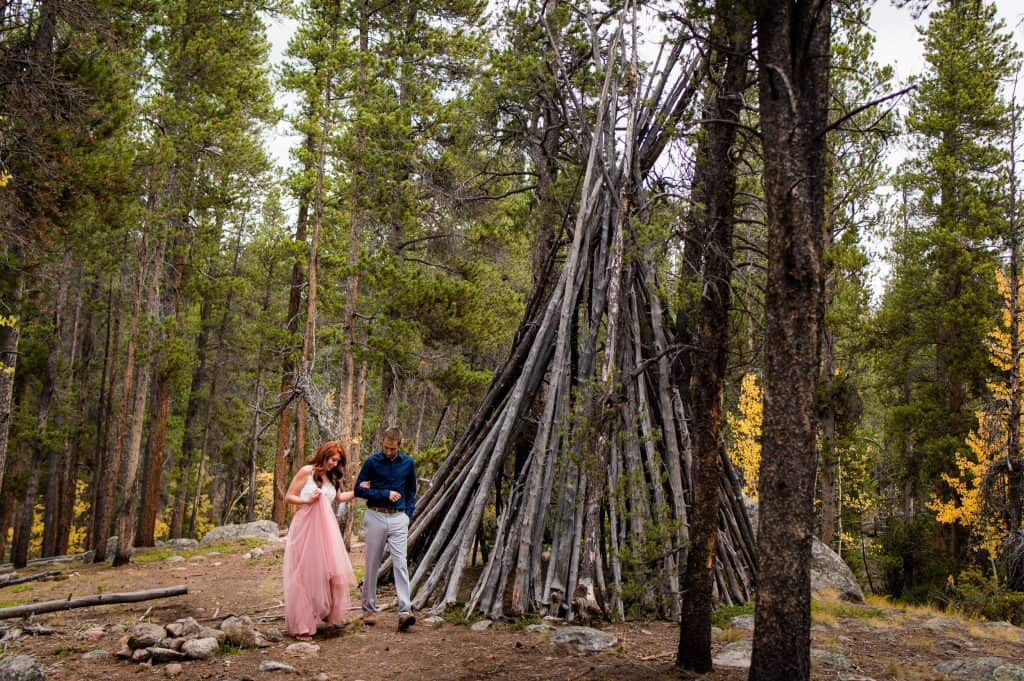 a couple walks through the forest in Colorado for their adventure lifestyle shoot