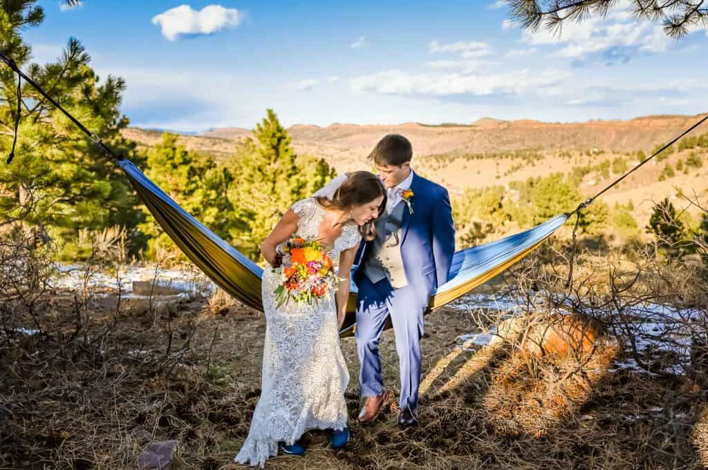 Couple lays in their hammock together after their backyard elopement on their farm in Lyons, Colorado