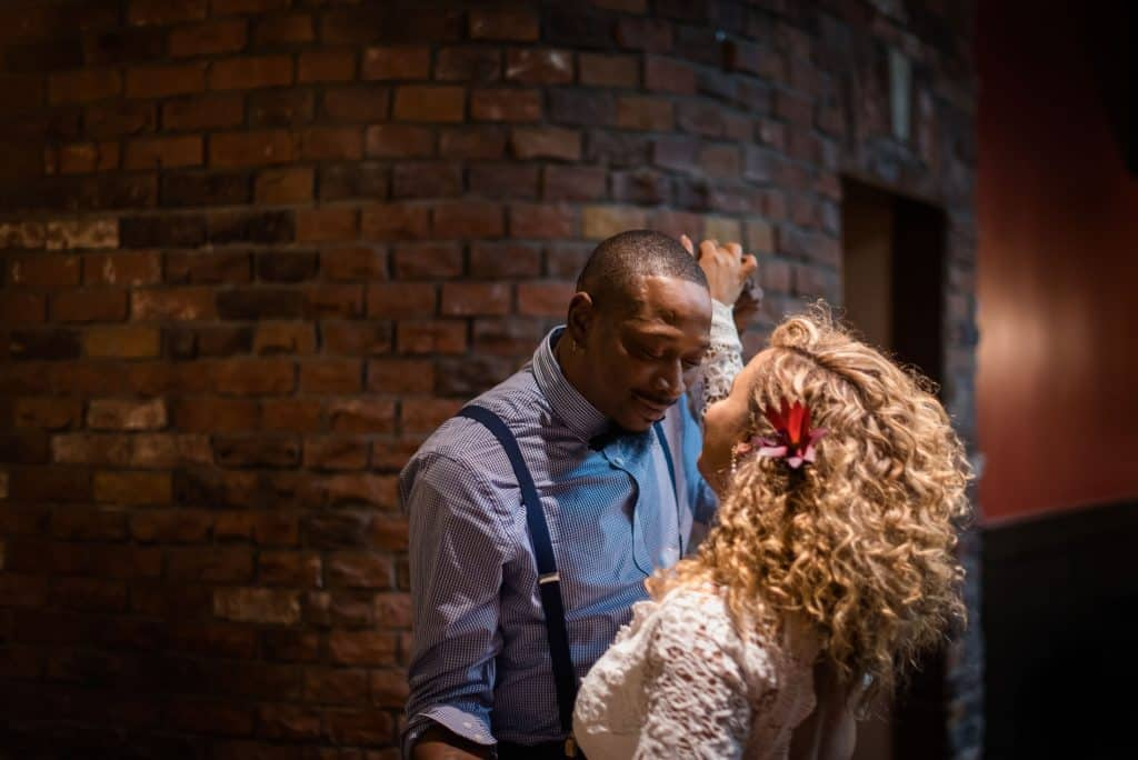 a couple dances together after their elopement ceremony at a speakeasy in Boulder, Colorado