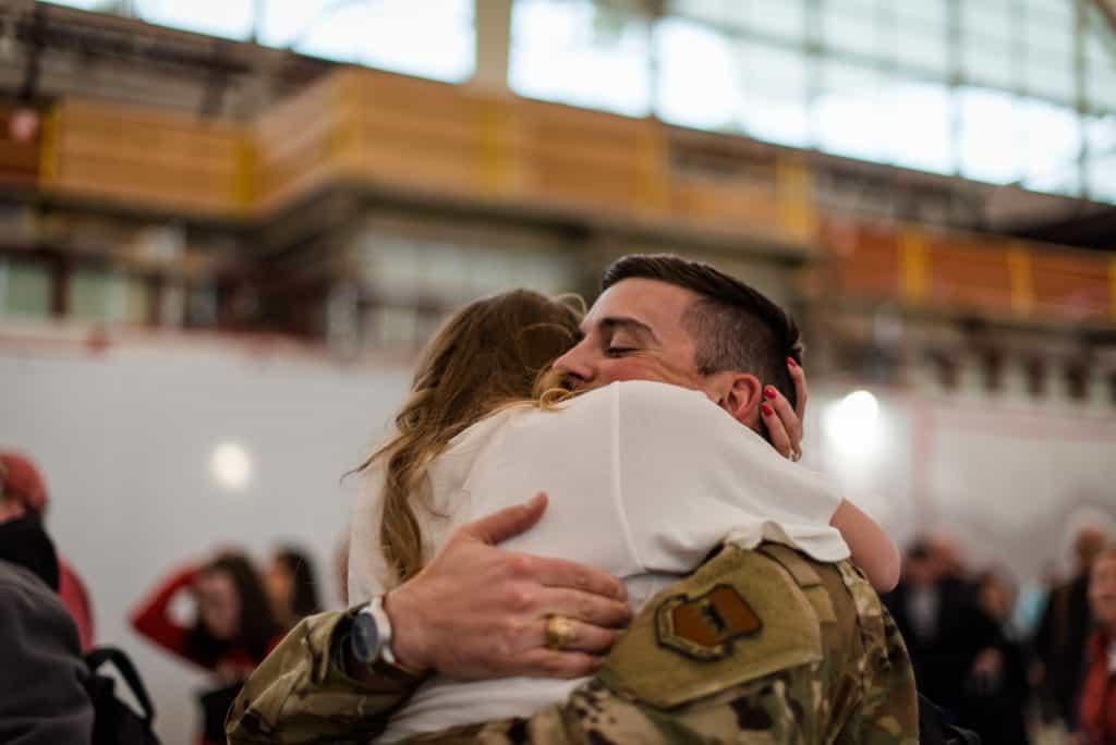 a soldier returns from deployment at denver international airport